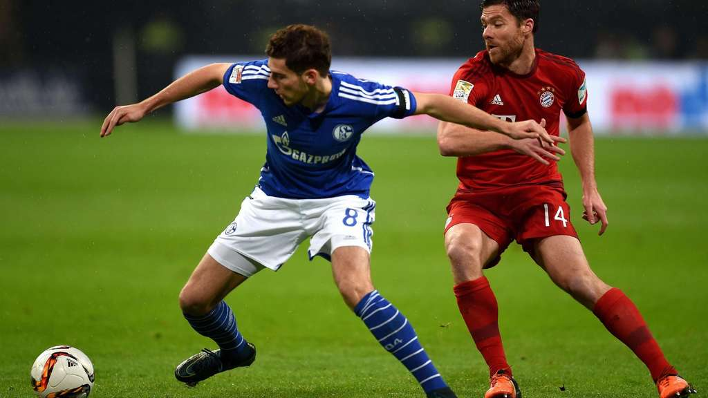 Schalke&#39s midfielder Leon Goretzka (L) and Bayern Munich&#39s Spanish midfielder Xabi Alonso vie for the ball during the German first division Bundesliga football match FC Schalke 04 vs FC Bayern Munich in Gelsenkirchen, western Germany, on November 21, 2015. AFP PHOTO / PATRIK STOLLARZRESTRICTIONS: DURING MATCH TIME: DFL RULES TO LIMIT THE ONLINE USAGE TO 15 PICTURES PER MATCH AND FORBID IMAGE SEQUENCES TO SIMULATE VIDEO. ==RESTRICTED TO EDITORIAL USE ==FOR FURTHER QUERIES PLEASE CONTACT THE DFL DIRECTLY AT + 49 69 650050.