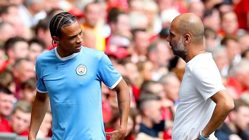 Leroy Sané und Man-City-Trainer Pep Guardiola. Foto: Martin Rickett/PA Wire